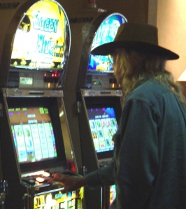 Man in front of slot machine.