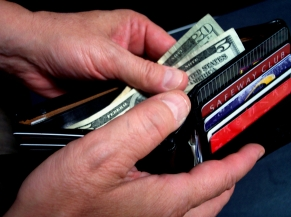 Picture of a wallet with cash and credit for personal finance basics illustration.