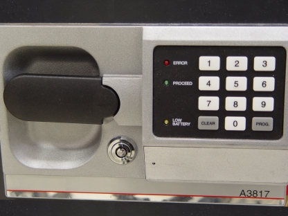 Net worth by age safe image with an electronic keypad