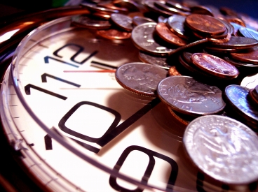 Picture of money on a clock, proving you should max out your retirement accounts