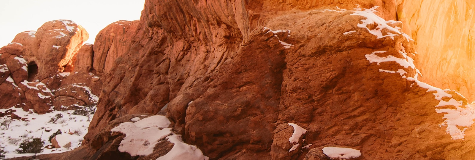 Red rock formation with sunlight streaming in.