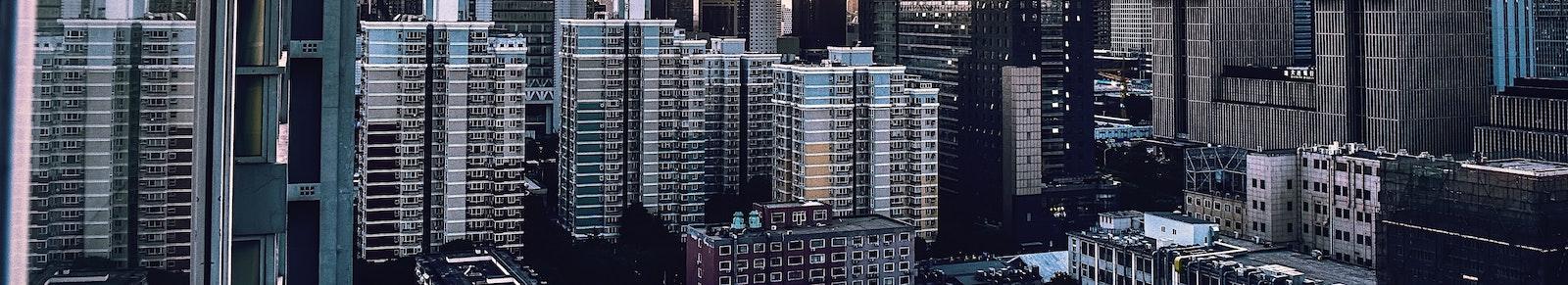 Buildings in a city representing a REIT return calculator