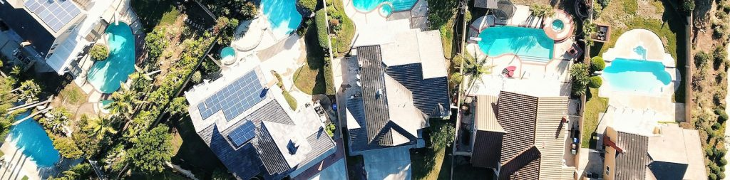 Picture of expensive houses with pools