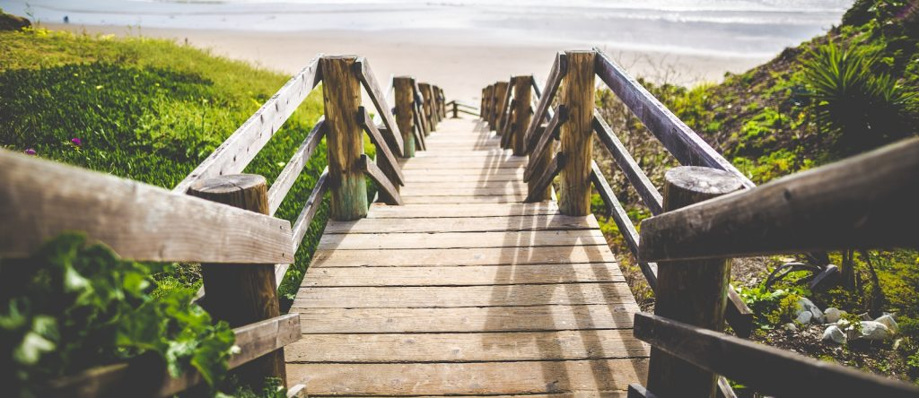 Path leading down stairs to the beach.