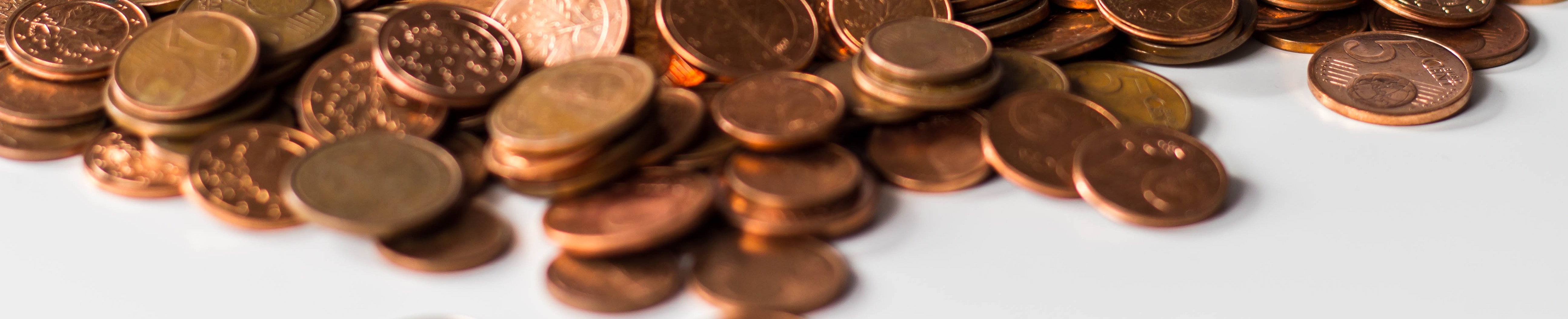 Pennies and copper coins in a pile.